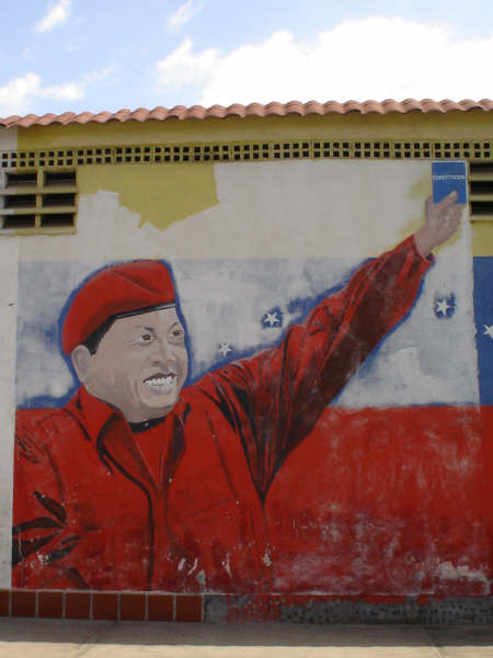 Chavez holding the 'blue book'.JPG