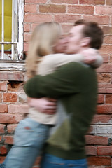 The Kiss (erin Michelle Photography) Tags: brick wall canon rebel hug kiss slowshutter embrace xti