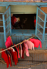 laundry day (biroe) Tags: china pink blue red window sweater nikon pants d70 laundry macau hangers 2pair impressedbeauty