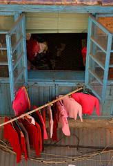 laundry day (biroe) Tags: china pink blue red window sweater nikon pants d70 laundry macau hangers 2pair impressedbeauty