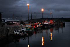 - last lights - (idogu) Tags: travel light sea color clouds boats flow island islands evening scotland orkney north picture stormy 2006 there come late available stromness scapa xxxxxxxxxxx thelast thisis staytuned travelerphotos ofmy4day triptothe morescotland shotsto