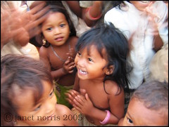 Kompong Speu village -the kids... (little.jafa) Tags: travel cute girl kids rural children happy blurry cambodia village child action homestay oxfam blackribbon applauding kampongspeu kiddywinks mundouno fotocompetition fotocompetitionbronze fotocompetitionsilver