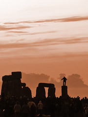 Stone Dancer Greets The Dawn (tarotastic) Tags: summer england sepia wow dawn dancer solstice stonehenge itsonginvite perfectingladolcevita universelookingup itsongpanasonicdmcfz20 itsongmirrorseurope stonehengesolstice
