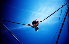 julia on bungee trampoline #5 (lomokev) Tags: blue sky fun lomo lca xpro lomography crossprocessed xprocess brighton julia action trampoline lomolca bungee agfa jessops100asaslidefilm agfaprecisa lomograph agfaprecisa100 juey cruzando precisa replaced jessopsslidefilm flickr:user=juey published:by=thecloud use:on=moo file:name=bgen1926hi roll:name=bgen19