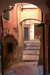 Old San Remo (jen clix) Tags: bricks arches walkway sanremo doors italy curves old