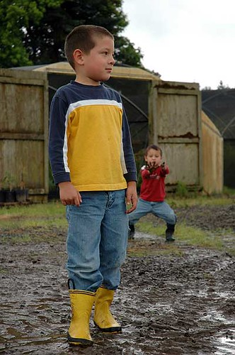 Antonio and Diego Playing in the Mud. Photo by J.D. Roth