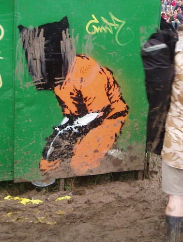 This graffiti image of a guantanamo prisoner was painted on one of the fences. This is of course welcomed at Glastonbury..., From ImagesAttr