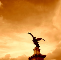 Fallen Angel? (Rome) (Giampaolo Macorig) Tags: angel apocalypse seppia sky clouds colors beautiful cool topv111 100v10f loveit topv333 topf25 top20favorites oneyear rome roma fallen angelo tevere statua ponte statue