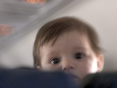 Visitor from Another Seat (Andrew Morrell Photography) Tags: baby plane fun guest eyes adorable vacation saucers lensbaby lensbabies 15fav topphotoblog
