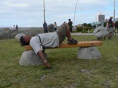 Day 21 Filipe Tohi resting on Brett Cooper's bench (te_kupenga) Tags: 2006 exhibition setup day21 brettcooper kupenga filipetohi gen06
