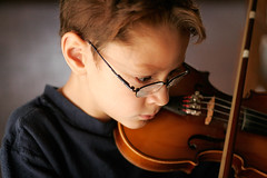 Portrait of a Young Violinist (Norby) Tags: 50mm top20childportrait n violin fv10 oneyear 50mm18 theface practicing ppnorby 650days tc37music utatafeature sywtbppoutdoornaturallight sywbppcandid tc79best oneyearcontest hpcube portfolio:name=sfw