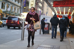 A woman with a banana on 49th Street between 8th Avenue and Broadway. (kevinrubin) Tags: newyork unitedstates us