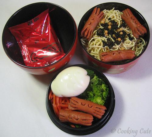 [bento bowl set with noodles, crab hotodogs, veggies, egg, instant soup mix]