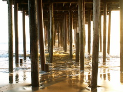 pier posts in sunwash (I, Puzzled) Tags: ocean light sunset sea santacruz beach bay amber pier waves bright dusk montereybay seacliff ipuzzled 2007 seacliffstatebeach 20070107 i500 200701 20070107163 scphoto