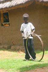boy with wheel (LindsayStark) Tags: africa travel boy portrait people children war sudan conflict humanrights humanitarian displaced idpcamp refugeecamp idp humanitarianaid emergencyrelief waraffected