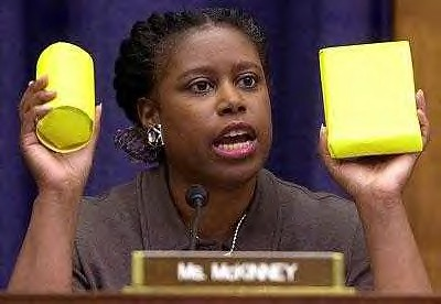 Former US Congresswoman from Georgia, Cynthia McKinney, holds up food packet and cluster bomb, both of which were being dropped on Afghanistan by the American military in late 2001. She ran as the  Green Party Presidential candidate in 2008. by Pan-African News Wire File Photos