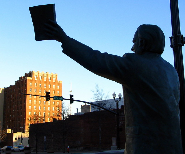 The Rev. Billy Graham Statue preaches to the James Robertson Apartments