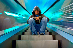 Gomez on 'The Light-Speed Escalator' (Brian Shaler) Tags: city longexposure blue friends light arizona portrait people motion blur color art phoenix stairs digital speed canon fun eos 350d rebel xt vanishingpoint hoodie intense long exposure sitting metro brian escalator cyan az topc100 topv9999 showcase tempe iconography topf500 topv99999 topv111111 topvaa topv10000 shaler outstandingshots topv100000 fotizmo refocusphoenix wowiekazowie refocusphoenix021907 mattsfirstblogphotoofthedaywinner32606 spectacularshots topcso