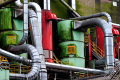 pipes (willy wonka style) (♫ marc_l'esperance) Tags: red brazil color colour green texture wet colors yellow metal stairs canon eos shiny raw industrial day colours geometry steel curves © pipes tubes machine textures rainy 10d northvancouver bent grime nocrop tubing uncropped railings grainelevator allrightsreserved patina 2007 chaotic cml gvrd canonef70200mmf28lusm canon70200f28l