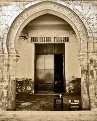 Former italian shop under the arcades on the port, Massawa, Eritrea (Eric Lafforgue) Tags: africa building architecture eritrea eastafrica aoi eritreo erytrea erythre eritreia  ericlafforgue ertra    eritre eritreja eritria wwwericlafforguecom  rythre africaorientaleitaliana     eritre eritrja  eritreya  erythraa erytreja