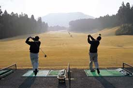 golfers swinging with ease on the range