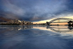 Sidney (saracino) Tags: bridge sea house storm water clouds sunrise reflections opera gulf harbour sidney superbmasterpiece