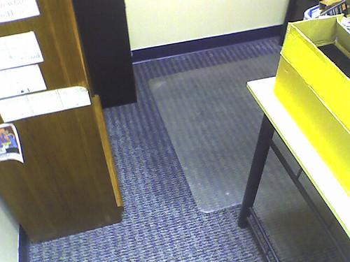 Wet floor in office from seeping sewage - 122406 008