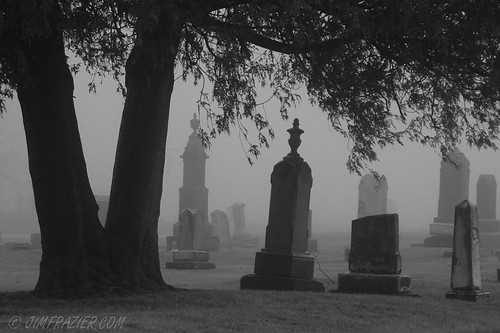 Black and white images of gravestones.