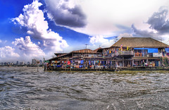 Shacks in the City (Stuck in Customs) Tags: blue houses sky water clouds thailand photography canal nikon photographer bangkok poor d2x shack hdr highquality d2xs stuckincustoms treyratcliff