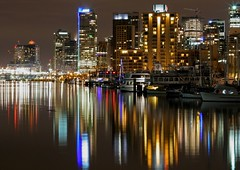 Vancouver at Night (A Sutanto) Tags: city canada reflection water skyline night vancouver marina buildings boats lights bay bravo downtown bc britishcolumbia burrardinlet stanleypark peopleschoice earthnight outstandingshots abigfave superaplus aplusphoto flickrplatinum 9pca canadacanadacanada