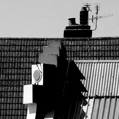 oh! (Harry Halibut) Tags: roof shadow chimney bw white art noiretblanc garage front sheets tiles deco tops tva allrightsreserved asbestos erial bexhillonsea 123bw contrastbysoftwarelaziness ©andrewpettigrew