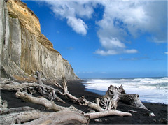 Volcano beach (Danil) Tags: ocean new wood travel blue sea sky cliff sun white mountain black beach water beautiful rock strand contrast wow landscape volcano vakantie cool sand scenery rocks open pair salt plymouth rocky reis zee mount driftwood zealand stunner uitzicht popular zwart slope hout vulcano taranaki egmont landschap nieuwzeeland vulkanisch sceney 3ofakind acehigh hawera forf 2pair aplusphoto youvsthebest superhearts flickrelite favescontestwinner