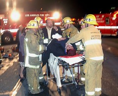 Firefighter Provide Care to Injured Motorist. Photo by Mike Meadows. Click to view more...