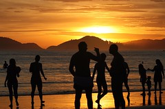 Sunsetters (Ricardo Carreon) Tags: sunset people men beach brasil women guaruja silouettes challengeyouwinner