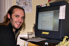 Photo of Danny in front of his computer while editing a Google Docs documment