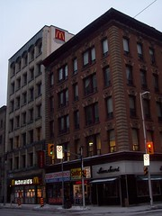 The Ronald McDonald building on Bank Street. (Steve Brandon) Tags: city winter snow ontario canada trafficlights building shop geotagged restaurant office store downtown magasin candy chocolate hiver ottawa fastfood streetphotography mcdonalds cheeseburger hamburger neige bigmac édifice queenst queenstreet 麥當勞 ville bonbons centreville conveniencestore chocolat goldenarches bankstreet bankst 加拿大 chickenmcnuggets laurasecord 麦当劳 eggmcmuffin マクドナルド ottawaphotography feuxdecirculation ruebank zoobaconvenienceandshawarma sootersphotographystudio ruequeen 安大略 渥太华 ottawaphotographer