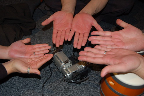 Red hands from playing with the bongos and clapping