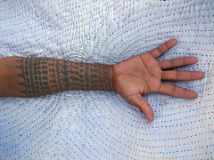 Hand-marked, Hand-made (Meanest Indian) Tags: india tattoo hands swastika tribal textile gujarat rabari kutch blowupbombay