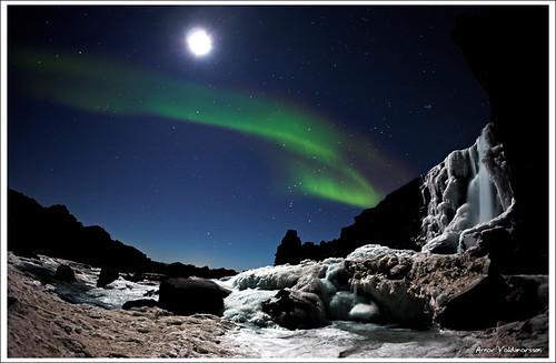 Moonshimmering waterfall and Aurora Borealis