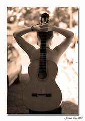 The shape of a woman (Jordan Lye) Tags: bw artistic guitar expression explore lovelovelove piratetreasure amazingtalent flickrsbest 35faves 25faves golddragon mywinners abigfave aplusphoto superbmasterpiece isawyoufirst diamondclassphotographer megashot piratetreasure2