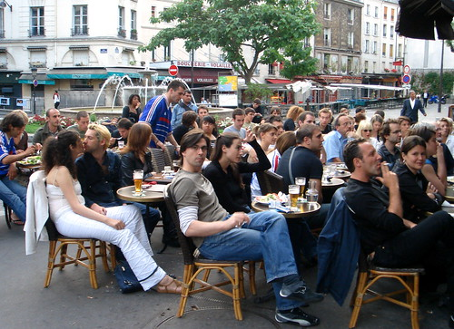 Even World Cup Soccer can't stop the kissing at a cafe on Rue MOuffetard, Paris