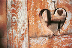 Hole in the Heart (EltonHarding) Tags: africa wood brown texture love broken 35mm bench out hearts hotel wooden carved interestingness chair day milner sad hole heart cut empty seat south side lord valentine romance explore valentines romantic rest artery lover contradiction varnish 10faves outstandingshots explore73 007238 maatijesfontein