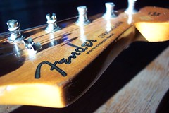 Fender Stratocaster  (Explore) (Tomitheos) Tags: wood music favorite neck photo google flickr post image guitar daily explore fender strings tuner pegs now fret gibson ebony stratocaster fenderstratocaster cbs 2007 encyclopedia electricguitar rosewood humbucker stockphotography pickguard whammybar march2007  guitardetails tomitheos march22481explore