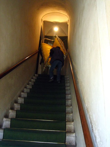 A restored couch goes up the stairs