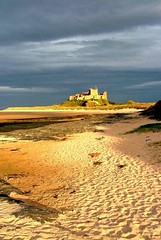 Bamburgh castle evening: EXPLORED (tina negus) Tags: beach evening seaside sand northumberland oldcity bamburghcastle supershot firsttheearth