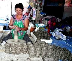 she is working.ร้านที่สาธิตการทำเครื่องปั้นดินเผาในเกาะเกร็ด จังหวัดนนทบุรี (Puykamo@Tнai) Tags: trip travel beautiful thailand lights tour handmade thai pottery neat nonthaburi นนทบุรี ท่องเที่ยว kohkret ลายไทย puykamo thaiproduct เกาะเกร็ด thaipottery thaitexture ลายวิจิตร แสงและเงา เครื่องปั้นดินเผา