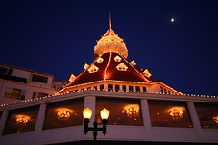 Hotel Del Coronado and Moon (FrogMiller) Tags: california lighting christmas ca xmas trip travel family roof light vacation sky moon holiday building history tourism beach beautiful architecture night canon buildings wow fun lights hotel coast interestingness amazing interesting lowlight holidays tour nightshot sandiego streetlamp famous victorian peaceful tourist tourists luna telescope coastal diningroom canon350d historical dining astronomy nightsky hotels lamps rebelxt coronado canoneos canonrebelxt lunar californian hoteldelcoronado coronadoisland beautifulbuilding nightskies robertmiller
