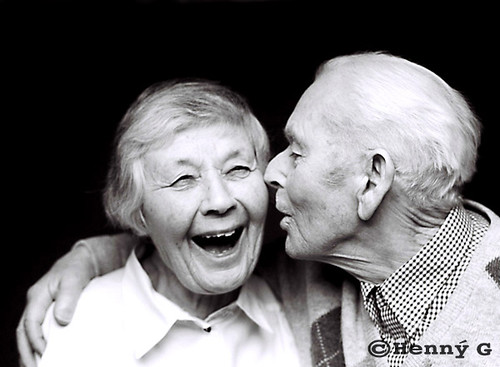Very old-aged couple sharing secrets and laughing