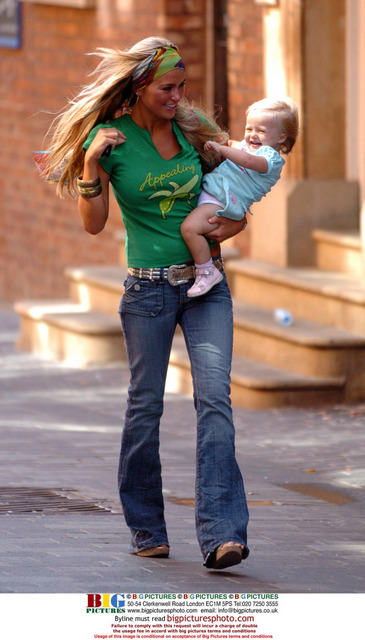 Alex Curran carrying her daughter Lilly-Ella