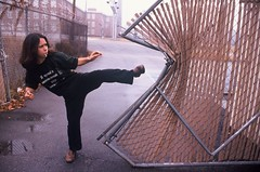 Sara (Michael Ronquillo) Tags: fence fight sara kick martialarts slidefilm dent girlpower nophotoshop nocrop kicking columbiasc december2000 littlekicks stillvision russiantshirt bymichaelronquillo michaelronquillophotography